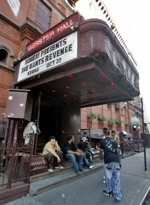 FILE- In this Oct. 22, 2007 file photo, workers at New York's Webster Hall take a break under the marquee. The New York City music venue shut its doors for the night after two people were injured on Friday, July 6, 2012, in what authorities say was a biting and slashing attack. (AP Photo/Richard Drew, File)