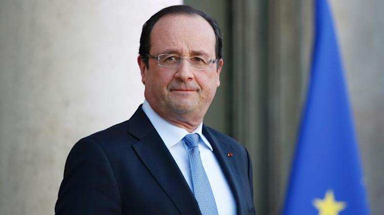 France's President Francois Hollande stands at the Elysee presidential palace on December 5, 2013 in Paris