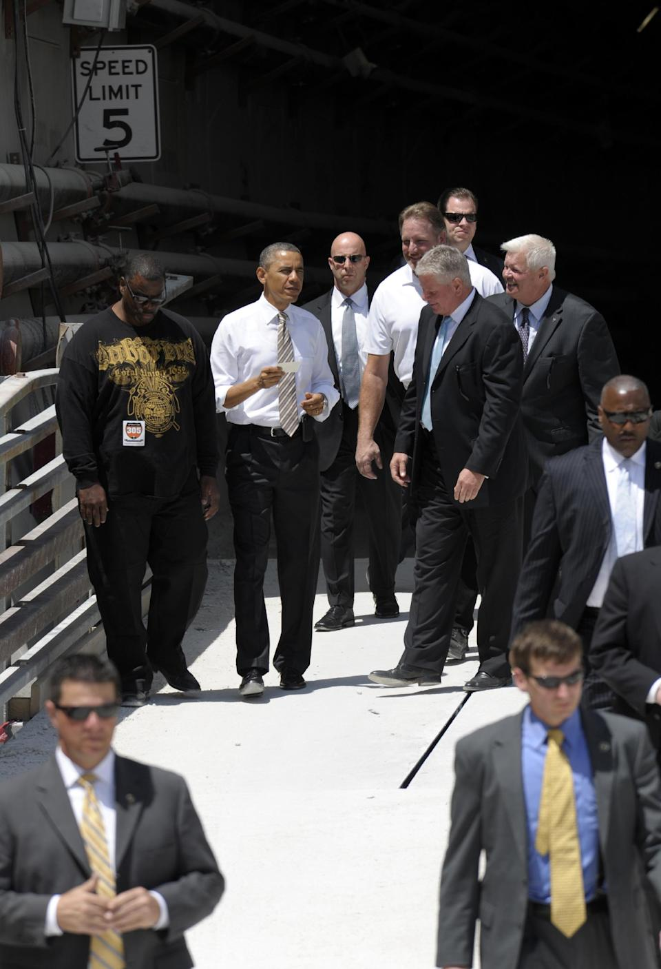 President Barack Obama tours a tunnel project at the Port of Miami, Friday, March 29, 2013, while promoting a plan to create jobs by attracting private investment in highways and other public works. (AP Photo/Susan Walsh)