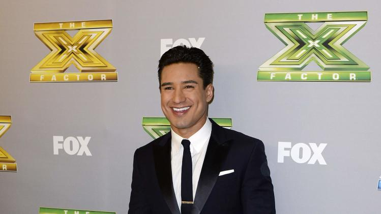 "Mario Lopez poses backstage after ""The X Factor "" finale in Los Angeles"