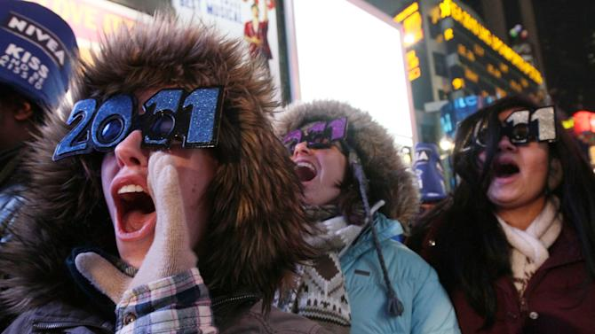 Shae Moxley, left, from Ashburn, Va., and others take part in the New Year's Eve festivities in New York's Times Square Friday Dec. 31, 2010. (AP Photo/Tina Fineberg)