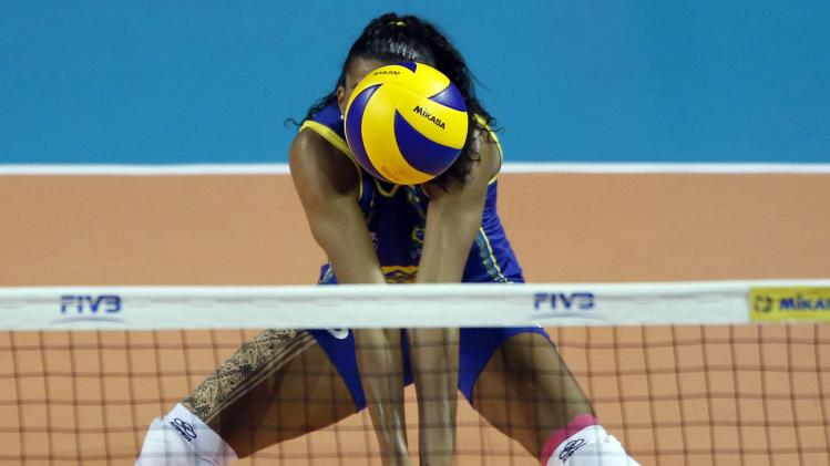 Fernanda Rodrigues of Brazil receives a serve from China during their FIVB Women's Volleyball World Grand Prix 2014 final round match in Tokyo