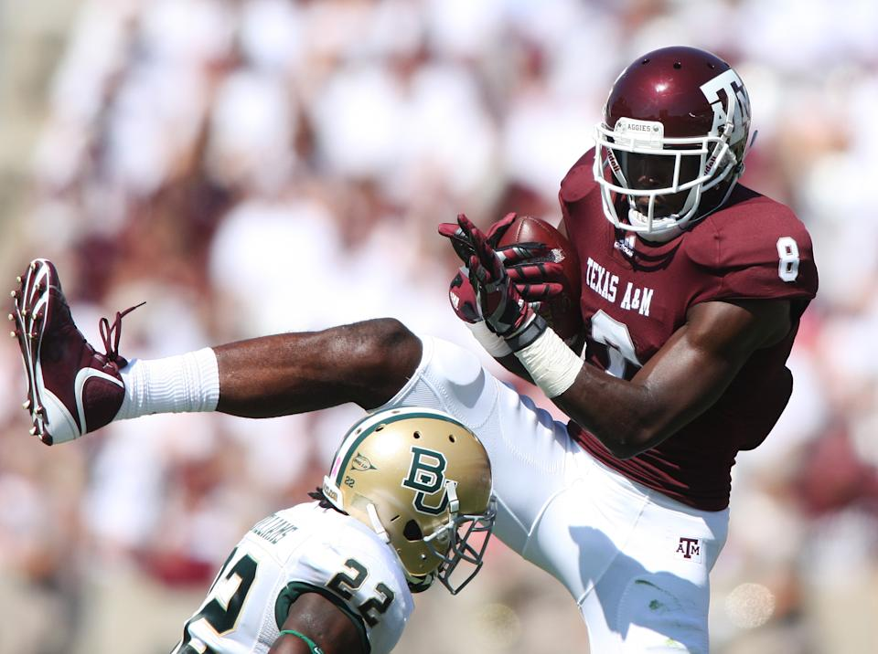 Texas A&M's Jeff Fuller (8) catches the ball over Baylor defender Joe Williams (22) during the first half of an NCAA college football game Saturday, Oct. 15, 2011, in College Station, Texas. (AP Photo/Jon Eilts)