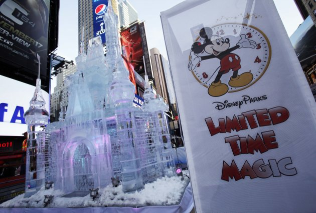 "A three-story castle made of ice is displayed in New York's Times Square, Wednesday, Oct. 17, 2012. On Wednesday, Disney announced a new program for 2013, ""Limited Time Magic,"" in which guests will encounter surprise weekly themes at Disney parks in Florida and California. The program was described as ""52 weeks of magical experiences big and small that appear, then disappear as the next special surprise debuts."" For example, a weeklong Valentine's Day celebration might include pink lighting on Disney castles, surprise meet-and-greets with Disney characters and candlelit dinners for lovebirds. (AP Photo/Richard Drew)"
