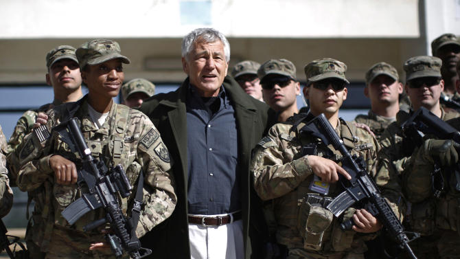 U.S. Defense Secretary Chuck Hagel, center, poses for a picture with members of the U.S. Army and Marines during his visit to the Kabul Military Training Center in Kabul, Afghanistan, Sunday, March 10, 2013. Hagel is on his first trip to Afghanistan as defense secretary. (AP Photo/Jason Reed, Pool)