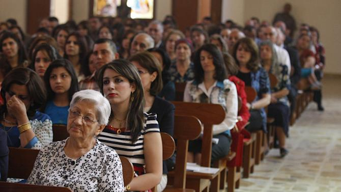 Iraqi Christians pray during Easter mass at Mar Youssif Chaldean Church in Baghdad, Iraq, Sunday, March 31, 2013. The Chaldean Church is an Eastern Rite church affiliated with the Roman Catholic Church. (AP Photo/ Karim Kadim)