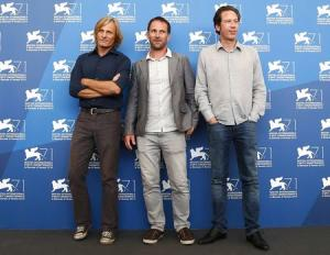 """Actors Kateb and Mortensen pose with director Oelhoffen during the photo call for the movie """"Loin des hommes"""" at the 71st Venice Film Festival"""