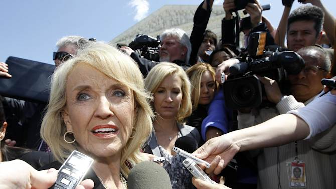 "Arizona Gov. Jan Brewer speaks to reporters outside the Supreme Court in Washington, Wednesday, April 25, 2012, after the court held a hearing on Arizona's ""show me your papers"" immigration law. (AP Photo/Charles Dharapak)"