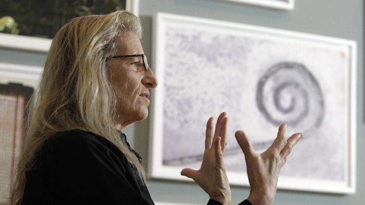 """Annie Leibovitz answers questions during an interview before the opening of her exhibition at the Wexner Center for the Arts Friday, Sept. 21, 2012, in Columbus, Ohio. Leibovitz's exhibition features work from her """"Master Set,"""" an authoritative edition of 156 images. (AP Photo/Jay LaPrete)"""