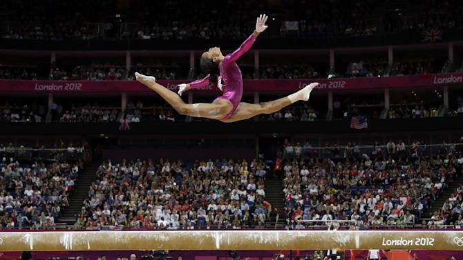FILE - In this Aug. 2, 2012, file photo, Gabrielle Douglas, of the United States, performs on the balance beam during the artistic gymnastics women's individual all-around competition at the 2012 Summer Olympics in London. Douglas, who became the first African-American gymnast to claim gymnastics' biggest prize _ the all-around Olympic title _ is The Associated Press' 2012 female athlete of the year. (AP Photo/Gregory Bull, File)