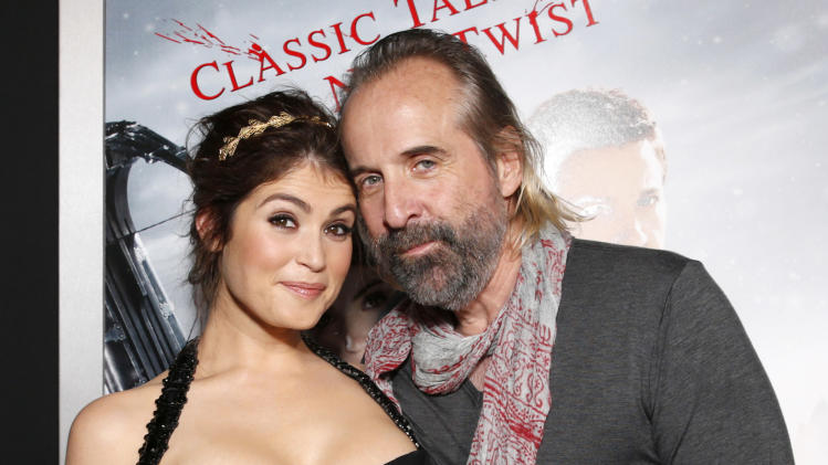 "Gemma Arterton and Peter Stormare arrive at the premiere of ""Hansel & Gretel Witch Hunters"" on Thursday Jan. 24, 2013, in Los Angeles.  (Photo by Todd Williamson/Invision/AP)"