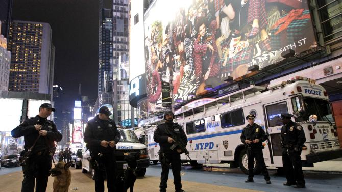 "FILE - In this Dec. 31, 2011 file photo, heavily armed police officers stand guard during the New Year's Eve celebration in New York's Times Square. The New York City police use an array of security measures for the event that turns the ""Crossroads of the World"" into a massive street party in the heart of Manhattan. (AP Photo/Mary Altaffer, File)"