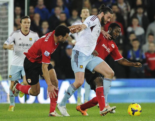 Cardiff City's Caulker and Theophile-Catherine challenge West Ham United's Carroll during their English Premier League soccer match in Cardiff