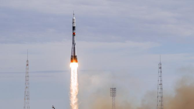 The Soyuz TMA-18M spacecraft carrying the crew of Aidyn Aimbetov of Kazakhstan, Sergei Volkov of Russia and Andreas Mogensen of Denmark blasts off from the launch pad at the Baikonur cosmodrome