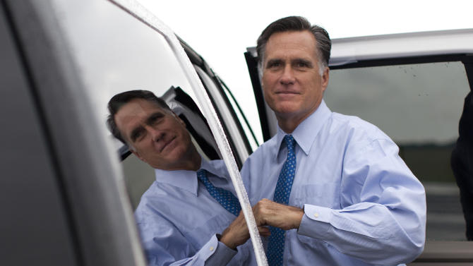FILE - In this Aug. 18, 2012 file photo, Republican presidential candidate, former Massachusetts Gov. Mitt Romney gets into his car to attend a fundraising event on Saturday, Aug. 18, 2012 in Nantucket, Mass. The unprecedented success of Romney to raise hundreds of millions of dollars in the costliest presidential race ever can be traced in part to a secretive data-mining project that sifts through Americans' personal information _ including their purchasing history and church attendance _ to identify new and likely, wealthy donors, The Associated Press has learned. (AP Photo/Evan Vucci)