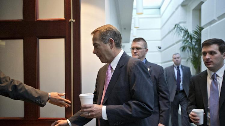 "House Speaker John Boehner of Ohio heads into a closed-door strategy session with GOP members, on Capitol Hill in Washington, Friday, Jan. 4, 2013, at the start of the first full day of business for the new 113th Congress. Yesterday, Boehner survived a suspenseful roll call vote for his speakership as some conservatives opposed his recent dealings over the ""fiscal cliff"" negotiations. The House plans to hold it's first vote on a Superstorm Sandy aid package today after a delay prompted Republican recriminations against the leadership. (AP Photo/J. Scott Applewhite)"