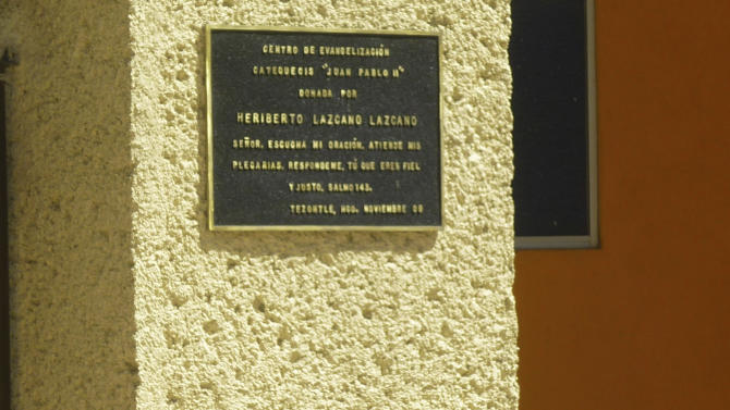 """FILE - This Oct. 20, 2010 file photo shows a plaque dated Nov. 2009 on the wall of a church in the neighborhood of Tezontle in Pachuca, Mexico. The plaque thanks the major donor who built the church, Heriberto Lazcano Lazcano, alleged leader of the Zetas, reading in Spanish """"Center for Evangelization and Catechism 'Juan Pablo II', donated by Heriberto Lazcano Lazcano, Lord, hear my prayer, listen to my plea. Answer me because you are faithful and righteous..Psalm 143.'  Mexico's Navy says fingerprints confirm that cartel leader Lazcano, an army special forces deserter, was killed Sunday, Oct. 7, 2012 in a firefight with marines in the northern state of Coahuila on the border with the Texas. (AP Photo/Victor Valera, File)"""