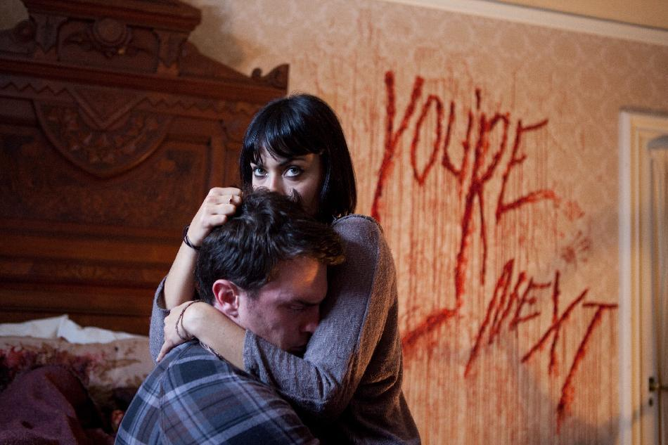"This film publicity image released by Lionsgate shows Nick Tucci and Wendy Glenn, right, in a scene from ""You're Next."" (AP Photo/Lionsgate, Corey Ransberg)"