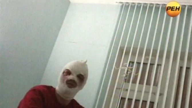 In this video grab provided by RenTV via APTN, artistic director of the Bolshoi ballet Sergei Filin gestures in a hospital in Moscow, Friday, Jan. 18, 2013 where he is being treated.  Filin, a 42-year-old former Bolshoi star, said a man threw the acid into his face late Thursday near the gate of his apartment building in central Moscow. Colleagues said Friday the could be in reprisal for his selection of dancers in starring roles at the famed Russian company.  (AP Photo/RenTV) TV OUT