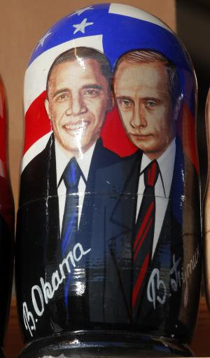 CORRECTS SPELLING OF MATRYOSHKA A traditional Russian Matryoshka wooden doll depicting US President Barack Obama and Russian President Vladimir Putin, on a display in St. Petersburg, Russia, Friday, Sept. 6, 2013. St. Petersburg is currently hosting the G-20 summit of world leaders . (AP Photo/Dmitry Lovetsky)