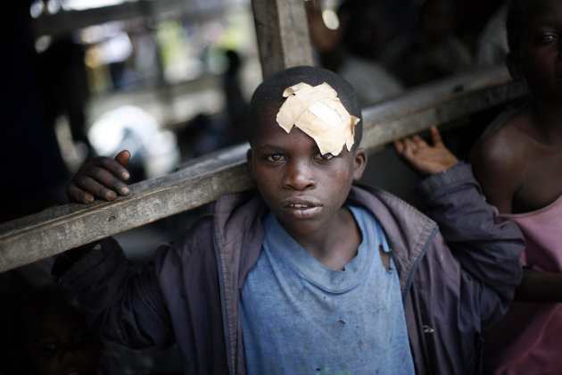 An internally displaced Congolese  boy waits for food to be distributed by WFP at the Mugunga 3 camp outside the eastern Congolese town of Goma Sunday Dec. 2, 2012. Rebels say they will take back Cong