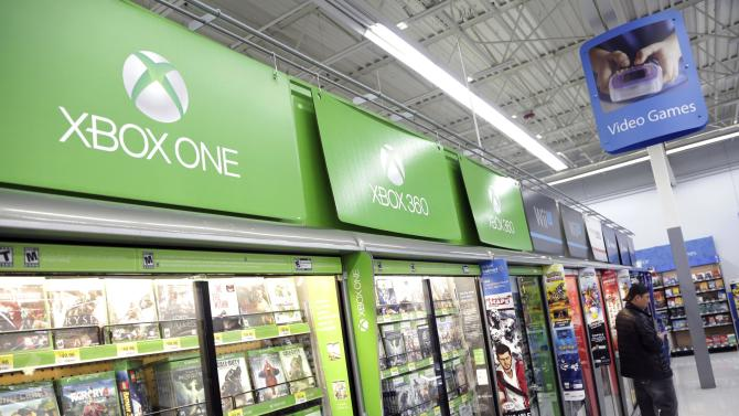 Man looks at video games at Wal-Mart ahead of Black Friday in Los Angeles