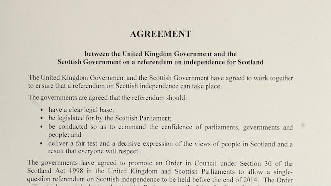 The referendum agreement signed by Prime Minister David Cameron, Scotland First Minister Alex Salmond, Scottish Secretary Michael Moore and Deputy First Minister Nicola Sturgeon during a meeting at St Andrews House in Edinburgh, Monday, Oct. 15, 2012. Cameron met with the leader of Scotland's separatist administration Monday to sign a deal on a referendum that could break up the United Kingdom. Officials from London and Edinburgh have been meeting for weeks to hammer out details of a vote on Scottish independence. Sticking points included the date and the wording of the question. (AP Photo/Gordon Terris, Pool)