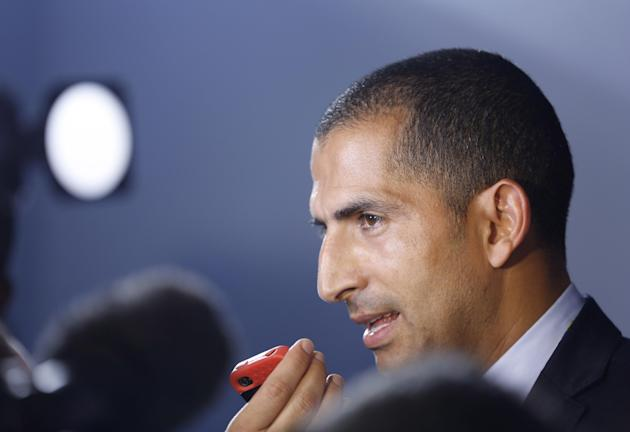 Ivory Coast head coach Sabri Lamouchi from France answers journalists' questions after  the draw ceremony for the 2014 soccer World Cup in Costa do Sauipe near Salvador, Brazil, Friday, Dec. 6, 20