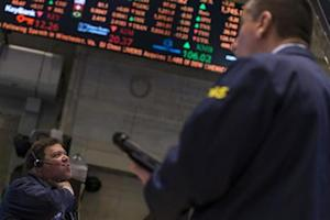 Traders work on the floor of the New York Stock Exchange February 4, 2014. REUTERS/Brendan McDermid