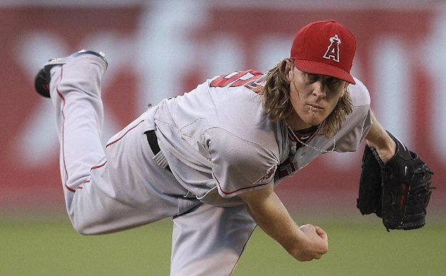 Los Angeles Angels&#39; Jered Weaver works against the Oakland Athletics in the first inning of a baseball game Monday, Aug. 6, 2012, in Oakland, Calif. (AP Photo/Ben Margot)