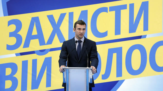 Former soccer star Andriy Shevchenko speaks to members of his party 'Ukraine - Forward!' during their session in Kiev, Ukraine, Friday, Oct. 19, 2012. Ukraine will hold parliamentary elections on October 28. Shevchenko  is a candidate to become a lawmaker in the list of the political party  'Ukraine - Forward!'. The poster reads: 'Defend your choice'. (AP Photo/Efrem Lukatsky)