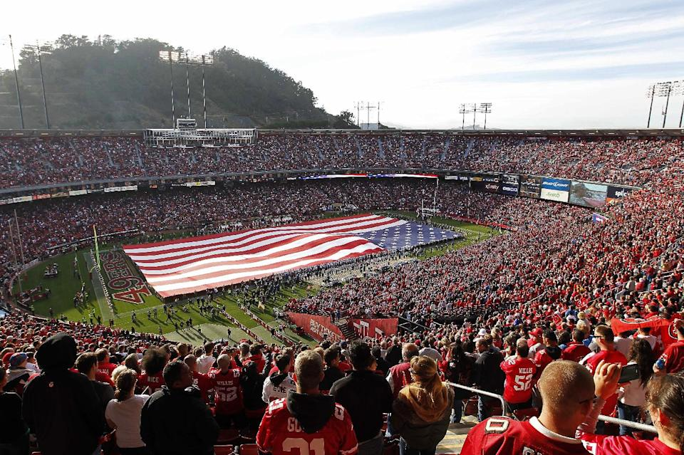 Fans in Candlestick Park cheer before an NFL football game between the San Francisco 49ers and the Detroit Lions in San Francisco, Sunday, Sept. 16, 2012. (AP Photo/Tony Avelar)