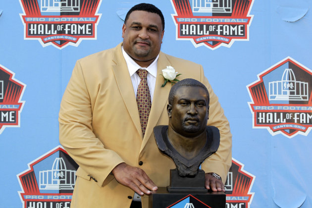 Former NFL football player Willie Roaf poses with a bust of himself during the induction ceremony at the Pro Football Hall of Fame on Saturday, Aug. 4, 2012, in Canton, Ohio. (AP Photo/Gene J. Puskar)