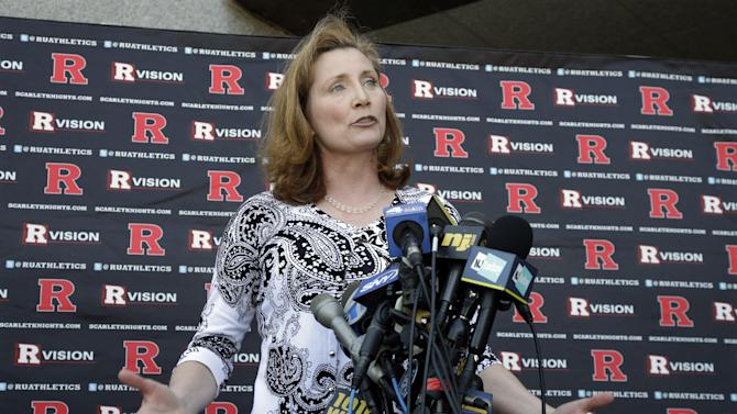 Rutgers incoming athletic director Julie Hermann answers a question during a news conference outside of the university's Hale Center in Piscataway, N.J., Wednesday, June 5, 2013. Hermann says the problems she encountered as a women's volleyball coach at Tennessee are part of the reason she's a good fit as a sports administrator. (AP Photo/Mel Evans)