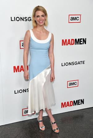 "FILE - In this Wed., March 20, 2013 file photo, January Jones, a cast member in ""Mad Men,"" poses at the season six premiere of the drama series at the Directors Guild of America, in Los Angeles. Jones, known for her daring red carpet looks, has topped many a best and worst-dressed list. The 35-year-old Hollywood mom says she could care less about what critics think of her style. (Photo by Chris Pizzello/Invision/AP, File)"