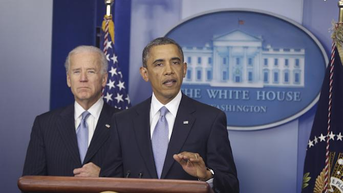 President Barack Obama and Vice President Joe Biden makes a statement regarding the passage of the fiscal cliff bill in the Brady Press Briefing Room at the White House in Washington, Tuesday, Jan. 1, 2013. (AP Photo/Charles Dharapak)