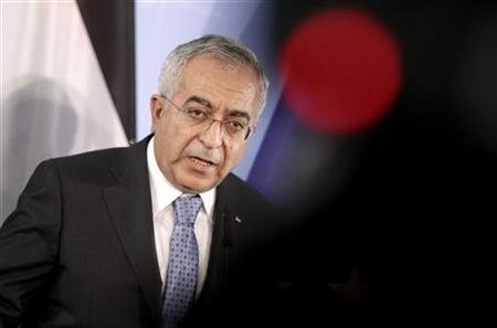 Palestinian Prime Minister Salam Fayyad addresses a news conference after talks with Germany's Foreign Minister Guido Westerwelle in Berlin March 28, 2012.