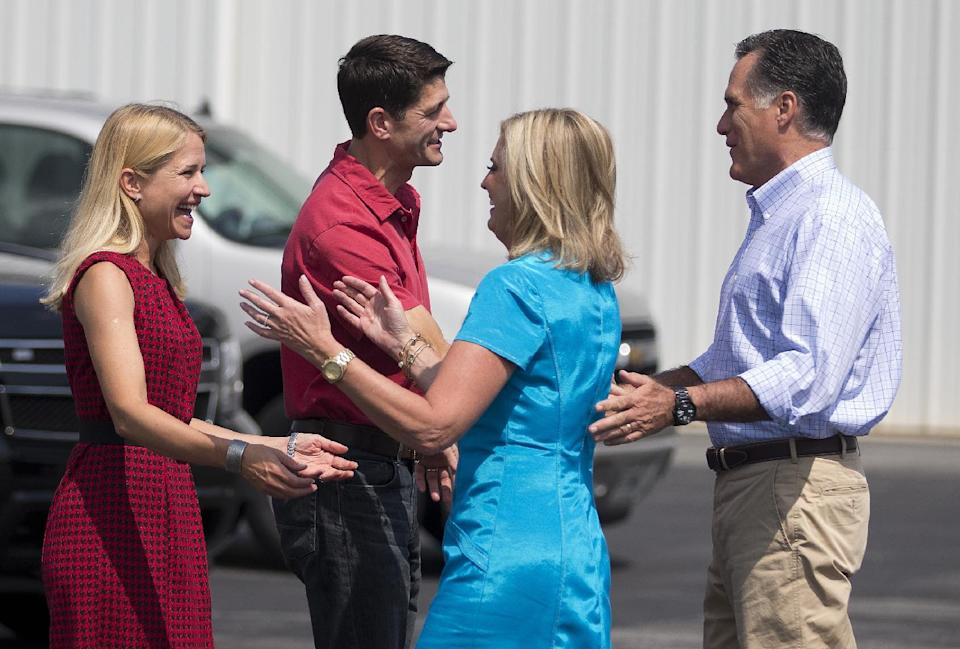 Republican presidential candidate, former Massachusetts Gov. Mitt Romney, right, and his wife Ann, meet up with his vice presidential running mate Rep. Paul Ryan, R-Wis., second from left, and his wife Janna, at Jacksonville International airport, Saturday, Sept. 1, 2012, in Jacksonville, Fla.  (AP Photo/Evan Vucci)