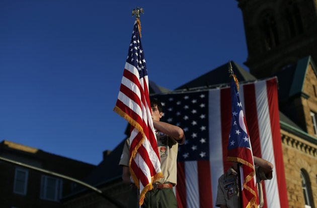 Boy Scouts stand at attention during the Pledge of Allegiance before Republican presidential nominee Mitt Romney's town square campaign rally in Lancaster, Ohio October 12, 2012.   REUTERS/Shannon Stapleton (UNITED STATES - Tags: POLITICS ELECTIONS USA PRESIDENTIAL ELECTION)
