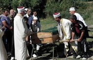 Muslim clerics and relatives attend the funeral ceremony of the Bulgarian Muslim bus driver Mustafa Kyosov in the village of Yurukovo, south of Sofia, after he was killed in a suicide bombing in Burgas on July 18. Bulgarian police along with the CIA, FBI and Interpol are struggling to identify a suicide bomber who killed six people, including five Israelis