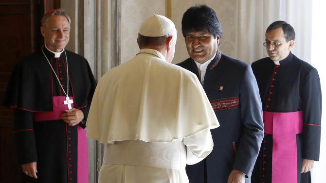 "FILE - In this Sept. 5, 2013 file photo, Pope Francis greets Bolivian President Evo Morales at the end of their meeting at the Vatican. Pope Francis is taking his ""church for the poor"" to three of South America's poorest and most peripheral countries, making a grueling, week-long trip that will showcase the pope at his unpredictable best: speaking his native Spanish on his home turf about issues closest to his heart. (AP Photo/Riccardo De Luca, Pool, File)"
