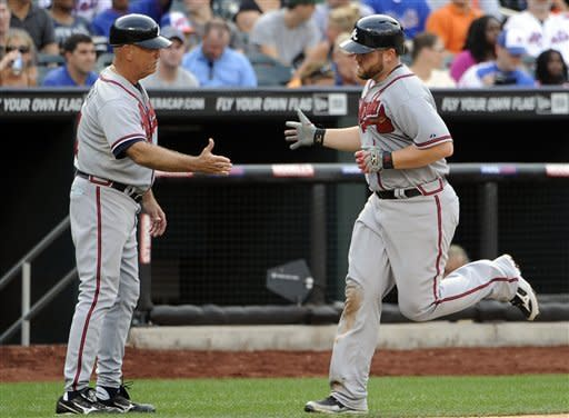Medlen, McCann and Braves storm past Mets 11-3