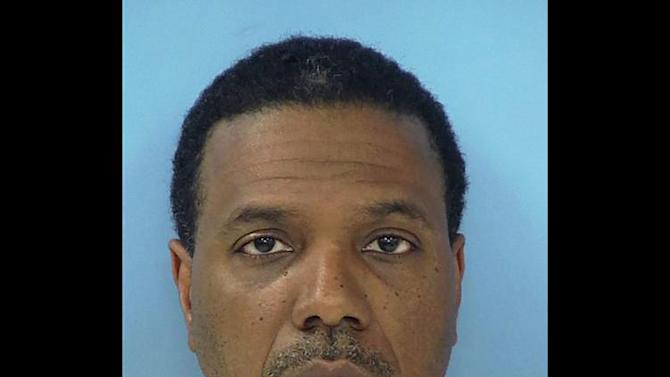 """This Friday, June 8, 2012 photo provided by the Fayette County Sheriff's Office shows megachurch pastor Creflo Dollar. Dollar has been arrested after authorities say he slightly hurt his 15-year-old daughter in a fight at his metro Atlanta home. Fayette County Sheriff's Office investigator Brent Rowan says deputies responded to a call of domestic violence at the home around 1 a.m. Friday. Rowan says the 50-year-old pastor and his daughter were arguing over whether she could go to a party when Dollar """"got physical"""" with her, leaving her with """"superficial injuries."""" (AP Photo/Fayette County Sheriff's Office)"""