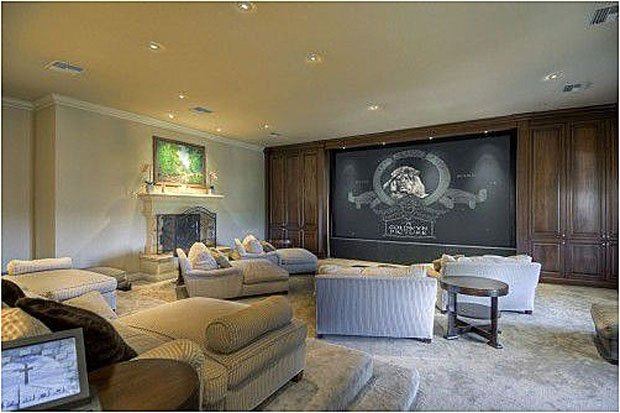 Nader Nazemi-The media room features a fireplace. (Zillow.com)