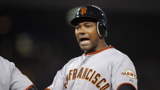 San Francisco Giants' Miguel Tejada celebrates after hitting an RBI-single during the fourth inning of a baseball game against the Los Angeles Dodgers, Wednesday, May 18, 2011, in Los Angeles. (AP Photo/Mark J. Terrill)