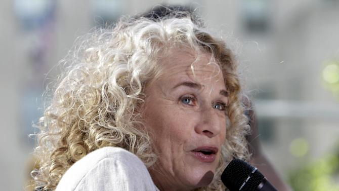 "FILE - This June 18, 2010 file photo shows Carole King performing on the NBC ""Today"" television program in New York. King is the first woman to win the Library of Congress' Gershwin Prize for Popular Song for her five decades of songwriting. (AP Photo/Richard Drew, File)"