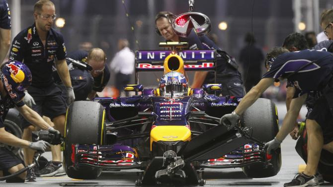Red Bull Formula One driver Daniel Ricciardo of Australia drives into the pit lane during the second practice session of the Singapore F1 Grand Prix at the Marina Bay street circuit in Singapore
