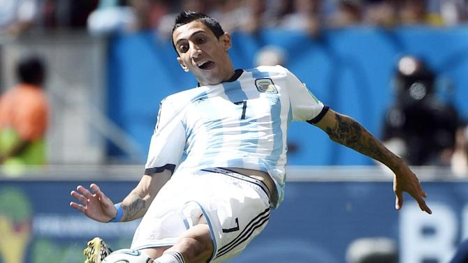 Argentina's midfielder Angel Di Maria kicks the ball during a quarter-final football match between Argentina and Belgium at the Mane Garrincha National Stadium in Brasilia during the 2014 FIFA World Cup on July 5, 2014