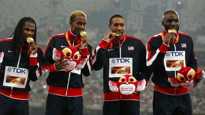 Members of first placed team USA Verburg, McQuay, Nellum and Merritt pose with medals during a ceremony after the men's 4x400 metres relay at the 15th IAAF World Championships at the National Stadium in Beijing