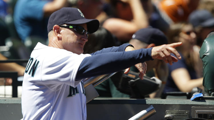 Seattle Mariners bench coach Robby Thompson gestures to a player during the third inning of a baseball game against the Cleveland Indians, Wednesday, July 24, 2013, in Seattle. Thompson was filling in for manager Eric Wedge for the third game in a row after Wedge suffered a dizzy spell and was hospitalized prior to Monday's game against the Indians. (AP Photo/Ted S. Warren)